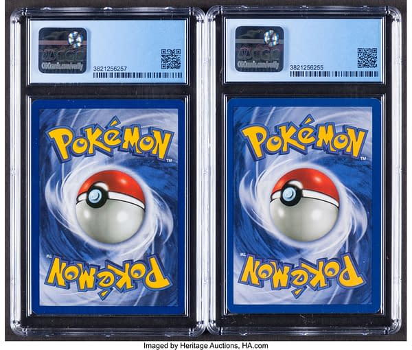 The rear faces of the pair of Mewtwo Pokémon TCG cards currently being auctioned at Heritage Auctions' website.