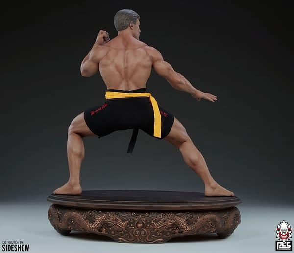 Jean-Claude Van Damme Receives 1:3 Scale Autographed PCS Statue