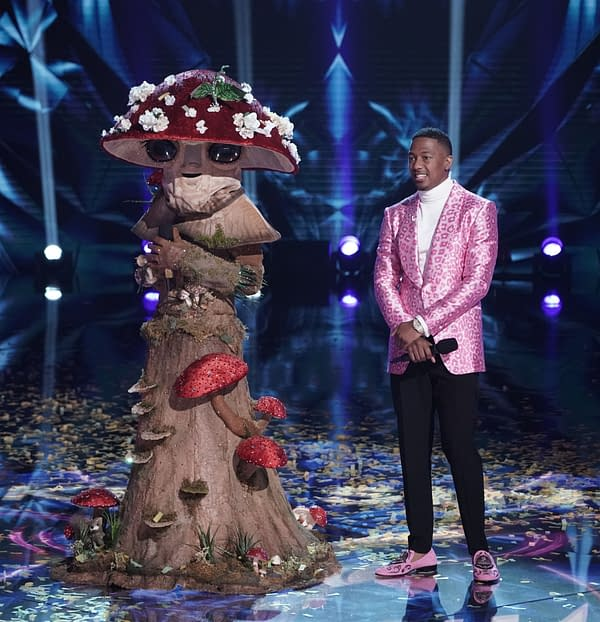 THE MASKED SINGER: L-R: Mushroom with host Nick Cannon in the