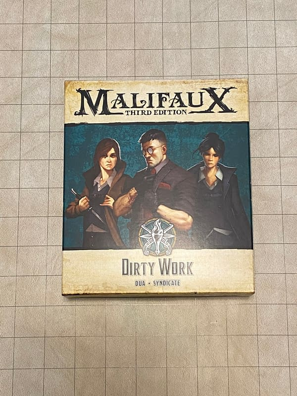 The front of the Dirty Work boxed set's packaging for Wyrd Miniatures' skirmish game, Malifaux.