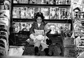 Girl at Newsstand