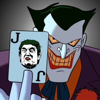An image of The Joker holding aloft a playing card with a picture of Donald Trump's face on it.