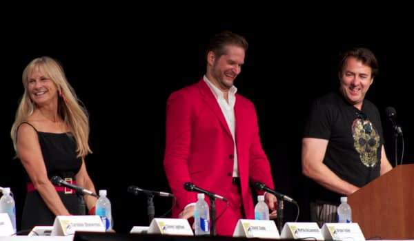 Hannibal executive producer_creator Bryan Fuller and executive producer Martha DeLaurentiis take their seats as moderator Jonathan Ross looks on