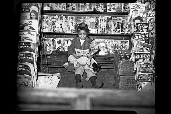 Charles-Teenie-Harris-Girl-reading-comic-book-in-newsstand