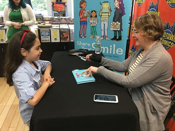 Raina Telgemeier Draws Crowds of Parents and Children at Midtown Comics Signing