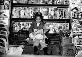 Girl at Newsstand
